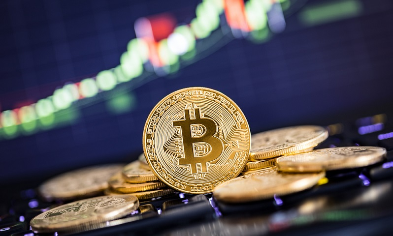 Kryptowährungen werden über Onlinedepots gehandelt und besitzen eine hohe Volatilität.  ( Foto: Shutterstock-REDPIXEL.PL )
